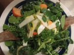Fuyu slices in salad with watercress and shaved white turnip