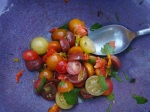 Nasturtium flowers cut into tomato salad with parsley