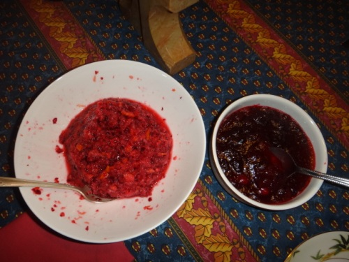 Two cranberry sauces at Thanksgiving last week: a raw sauce (cranberries, an entire orange, sugar and salt thrown into the food processor); and a cooked sauce (cranberries simmered with sugar until gooey).